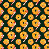 christmas seamless pattern with oranges and candy canes on dark green background. watercolor holiday illustration.