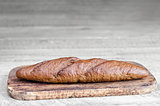 Bread is on grey wooden background