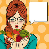 Surprised pop art  woman that holds vegetables  in her hands . C