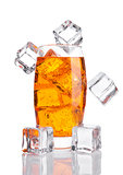 Glass of orange energy soda drink with ice cubes