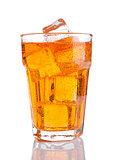 Glass of orange energy soda drink with ice