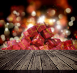 3D Christmas background with wooden table looking out to a stack