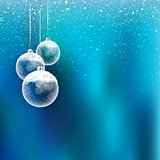 Christmas baubles with snow