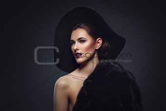 Beautiful girl in fur coat and hat