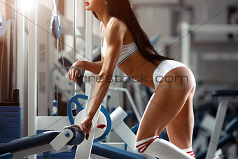 Beautiful young woman posing in the fitness gym
