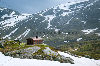 Small house at snowy mountain plateau, Norway