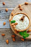 Freshly ground almond flour and raw almonds.