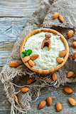 Wooden bowl with almond, mint and almond flour.
