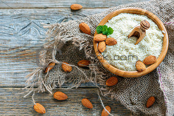 Almond flour in a wooden bowl.