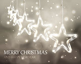 Christmas background of de-focused lights with decorated stars