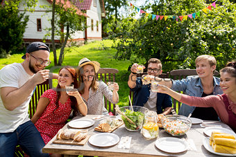 happy friends having party at summer garden