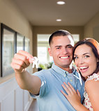 Military Couple with House Keys Inside Hallway