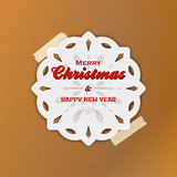 Christmas snowflake with sellotape on brown paper