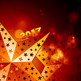 Festive golden stars 2017 over glowing background