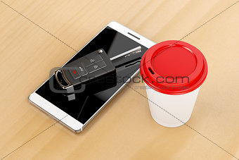 Smartphone, car key and coffee