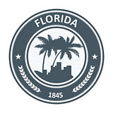 Florida emblem with palm tree and city silhouettes