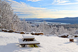 Snow Covered Picnic Table with a View