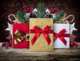Xmas grunge decoration background with presents on wooden boards