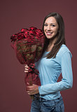 Happy young woman with roses