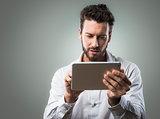 Attractive man using tablet