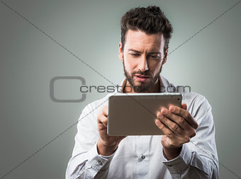 Attractive man using tablet