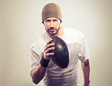 Handsome football player with ball