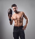 Shirtless football player with ball