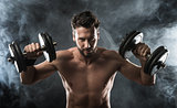 Attractive man weightlifting