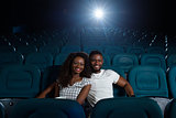 Happy African couple at the cinema
