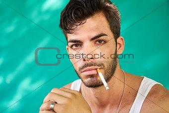 Portrait Of Young Hispanic Man Smoking Cigarette