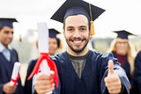bachelor showing diploma and thumbs up