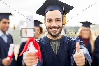 bachelor showing diploma and thumbs up