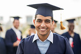 happy student or bachelor in mortar board
