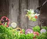 Background of mixed salad on wooden boards