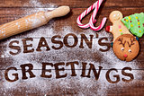 christmas cookies and text seasons greetings