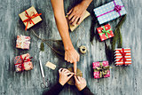 young woman and man wrapping gifts