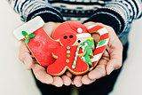 man with christmas cookies in his hands