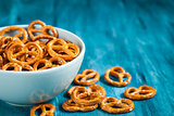 Salty snacks mini pretzels in bowl