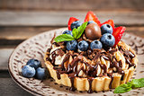 Banoffee chocolate pie decorated with chocolate, fresh blueberry