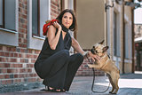 Beautiful woman with dog on the street