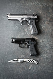 handguns and offensive knife