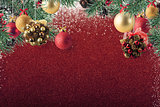 Xmas decoration on sparkly red glitter background