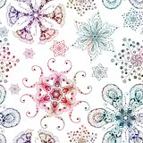 Seamless pattern with multicolored snowflakes on white background. Christmas vintage vector.