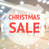 Christmas season sale sign over blurred background