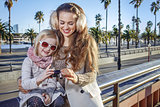 mother and daughter in Barcelona viewing photos on camera