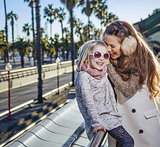 mother and daughter travellers having fun time in Barcelona