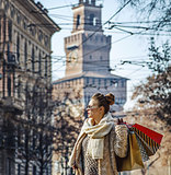 trendy traveller woman in Milan, Italy looking into distance