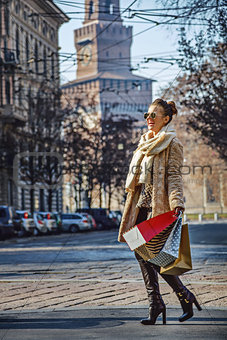 tourist woman near Sforza Castle in Milan, Italy walking