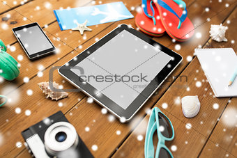 close up of tablet pc and travel stuff