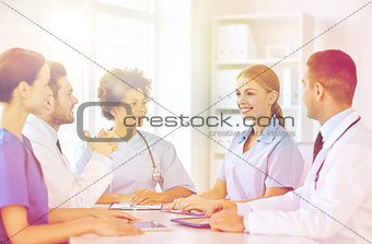 group of happy doctors meeting at hospital office